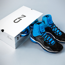 Ua-cam-highlight-trainer-pair_box_blue-heat_black_metallic-silver