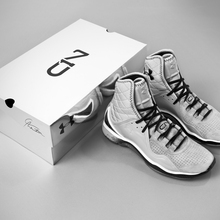 Cam_highlight_trainer_veneer_white_black_shoe_box