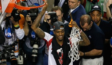Injured-louisville-guard-kevin-ware-celebrates-after-cutting-down-the-net-after-his-team-beat